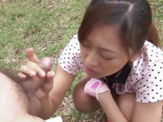 Japanese teen is on her knees sucking cock outdoors blowjob brunette hairy
